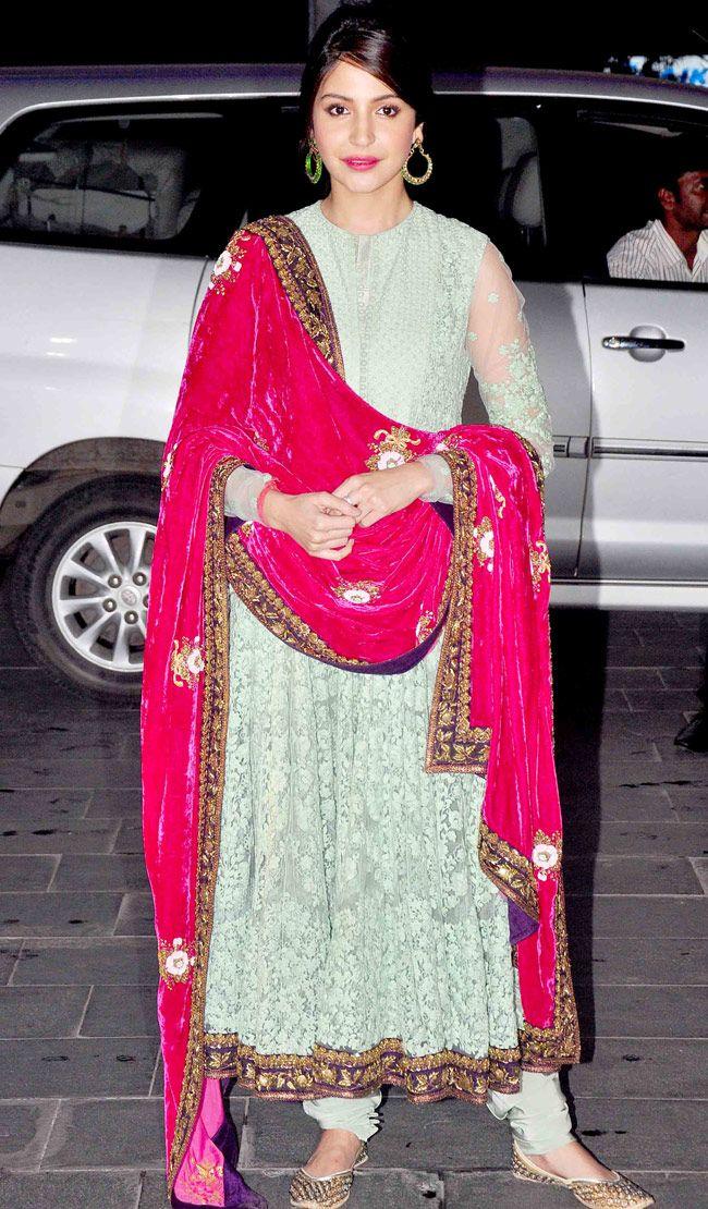 Anushka Sharma in a red velvet dupatta and Anarkali dress at Shirin Morani's wedding reception.