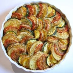 """This is one of my biggest """"wins"""" thus far from Pinterest.  I made it this summer with produce from my garden (I didn't use potatoes, however, since I didn't have any), it was DELICIOUS and it looked gorgeous too!_____________________    Vegetable Tian - a beautiful side dish with potatoes, tomatoes, yellow squash, zucchini, caramelized onions and garlic."""