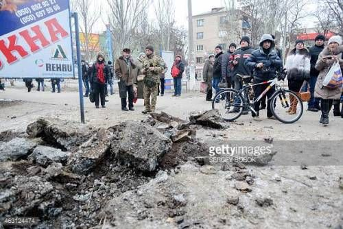 06-23 People examine a crater after shelling in eastern... #kramatorsk: 06-23 People examine a crater after shelling in… #kramatorsk