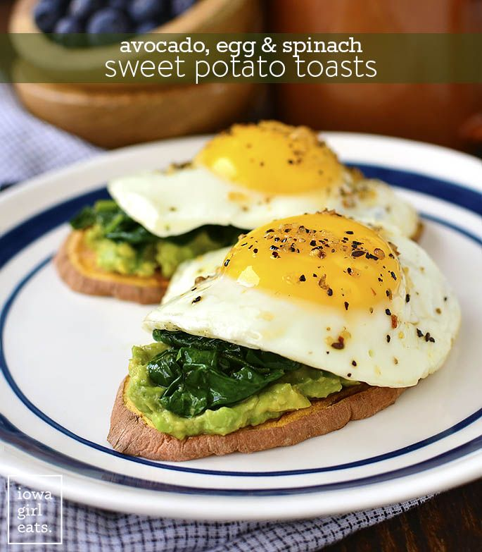 "Avocado, Egg and Spinach Sweet Potato ""Toasts"" - This healthy, gluten-free breakfast recipe packs a healthy punch of protein, vitamins, and minerals."