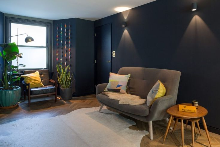 Loaf's retro Berlin sofa in velvet in this dark hued snap from Dezeen