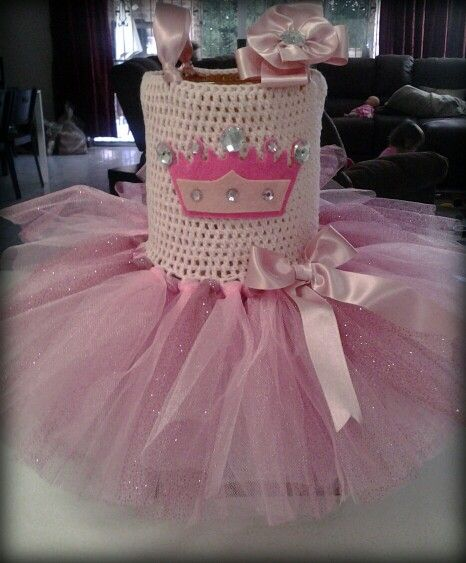 Princess crown tutu dress. Hand crocheted top with stretch yarn, felt crown detail with pretty gems. Soft pink glitter tulle skirt. Adjustable satin ribbon shoulder straps.