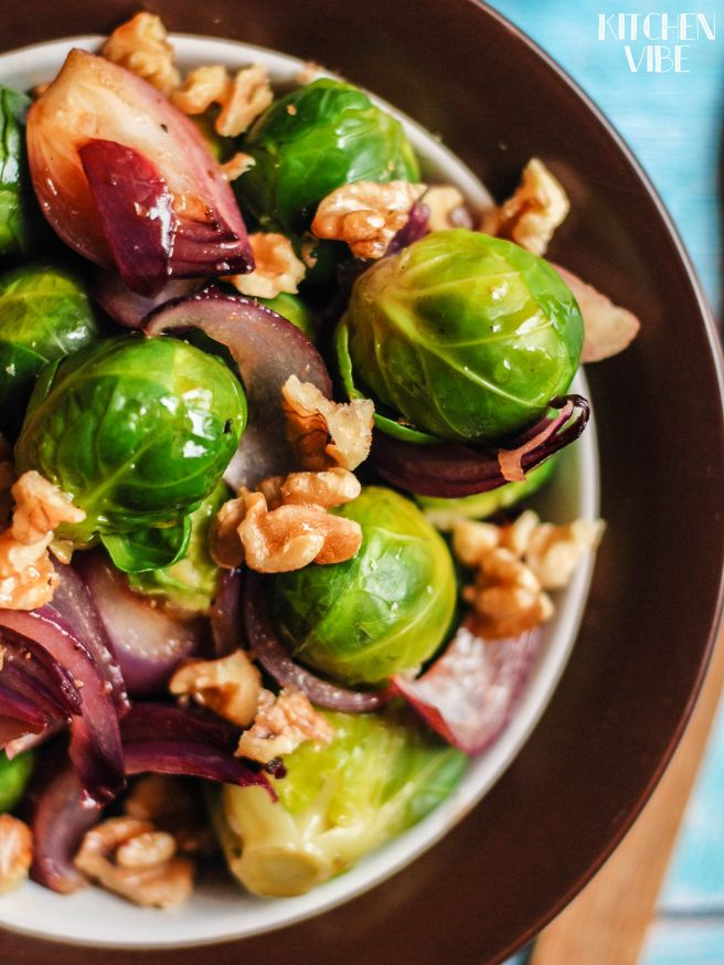 brussel sprouts salad with nuts and red onion