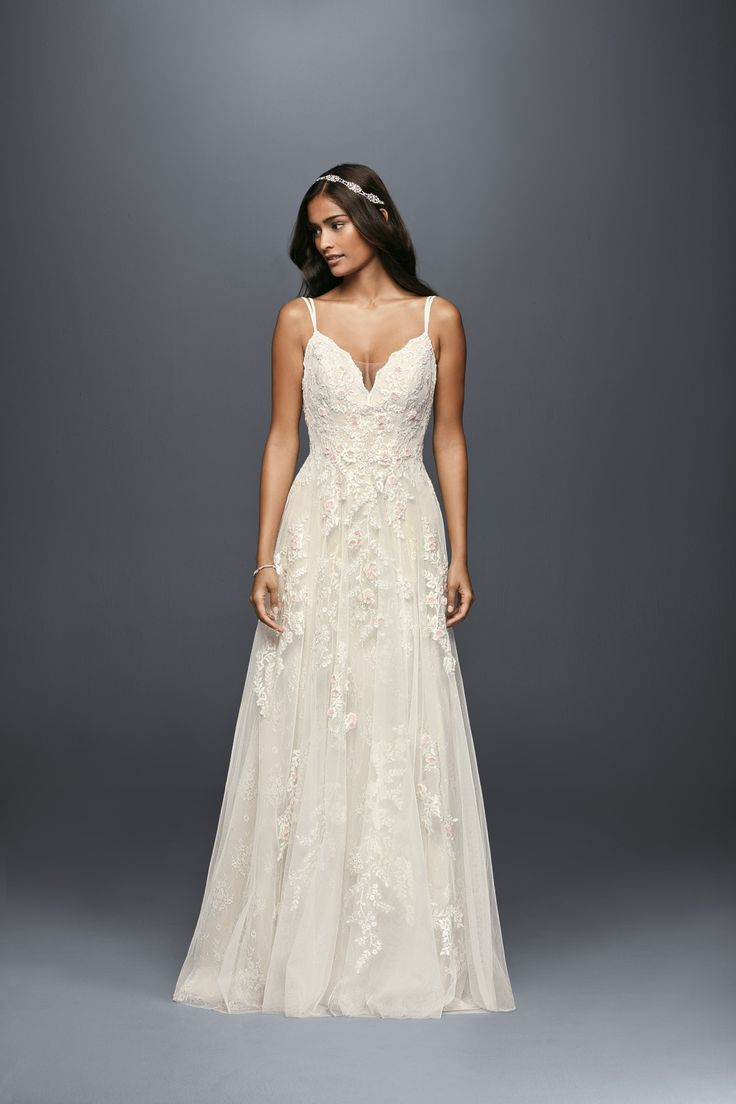 Irresistibly ethereal. This simple, but anything but boring, a-line wedding dress features blush flowers and a scallop hem. | Spaghetti Strap Illusion V-Neck Scalloped A-line Wedding Dress by Melissa Sweet available at David's Bridal