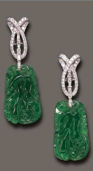 A PAIR OF JADEITE AND DIAMOND EAR PENDANTS  Each designed as a circular and tapered baguette-cut diamond scroll motif, suspending a carved jadeite plaque, mounted in 18k white gold