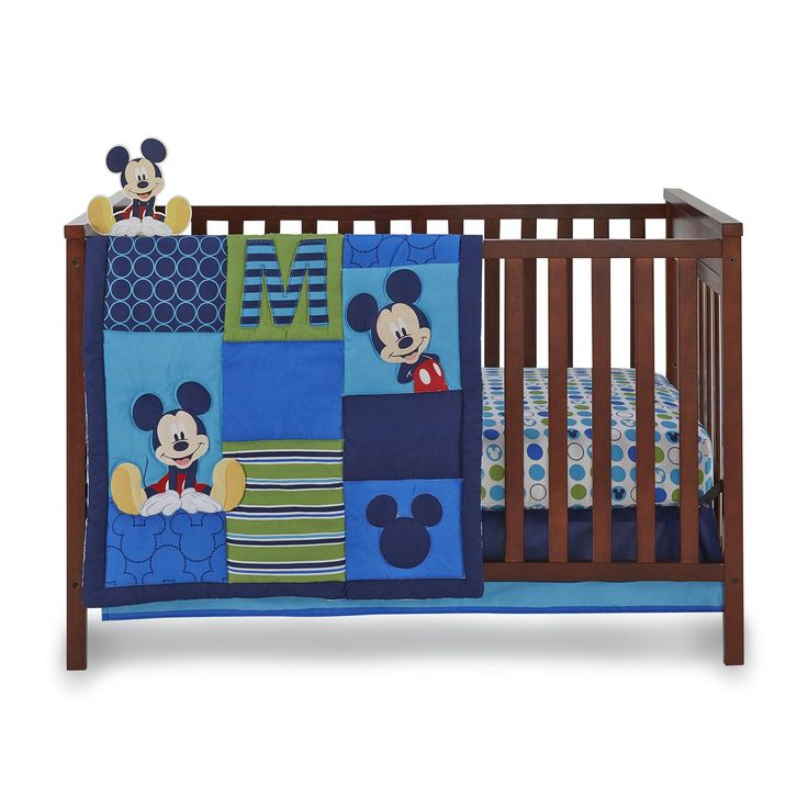 Decorate your baby's nursery with colorful and engaging decor with this Disney Baby four-piece Mickey Mouse crib bedding set. Add a little Magic Kingdom style with this sweet set that's made to fit standard size cribs and includes a comforter, fitted sheet, dust ruffle and wall decoration starring Mickey Mouse.