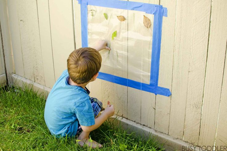 Create a fun, easy activity with this outside sticky wall. Kids will love sticking outdoor treasures to this sticky wall in this quick, simple activity,