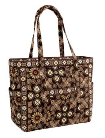 Get Carried Away Tote   Vera Bradley I Canyon.  The ultimate in travel, our Get Carried Away Tote is designed to function as a travel companion. Unique, breakaway zipper gives the option of securely closing the bag (like a duffel or luggage item) or leaving it wide open! Tons of pockets (some plastic-lined!) and positionable shoulder pads make traveling comfortable and easy. Go ahead, Get Carried Away!