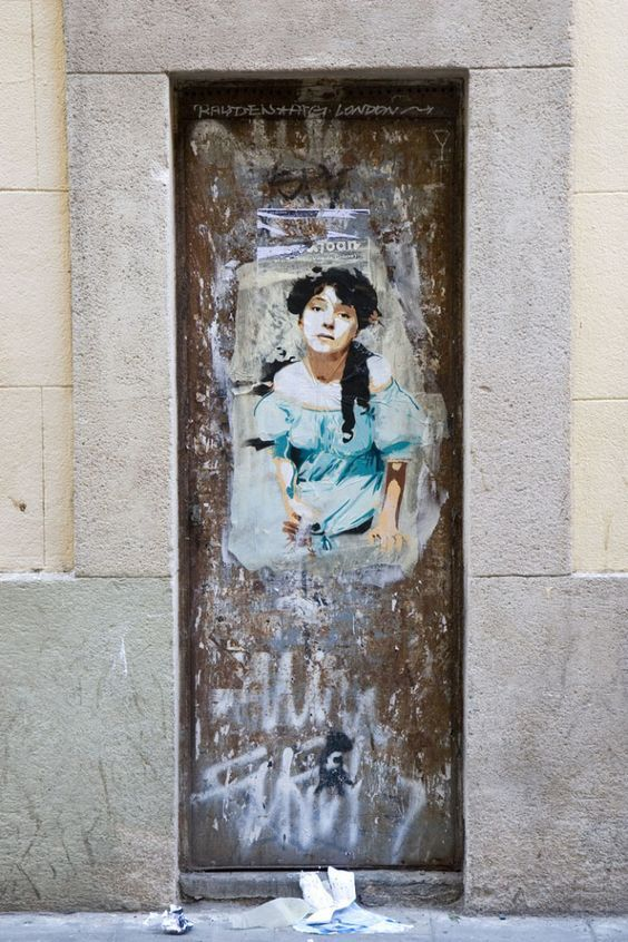 It seems this woman is dressed in traditional Spanish clothing. She is surrounded but graffiti and has a look of desperation on her face. This may be a reminder to remember the past, even when things in the present get messy.