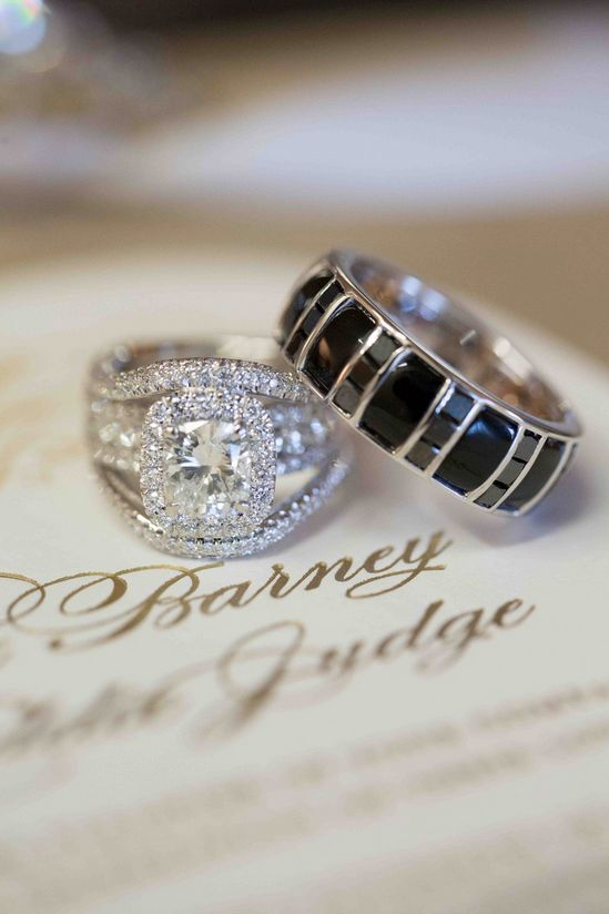 Tamra Barney's engagement ring featured exquisite diamond halo and pavé details, while Eddie Judge's band featured masculine black stones. #weddingrings Photography: Christine Bentley Photography. Read More: https://www.insideweddings.com/weddings/tamra-barney-and-edward-judge/471/
