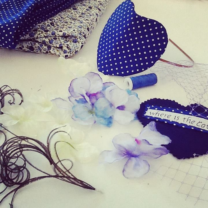 in process blue & white headpiece heart shaped mounted on headband