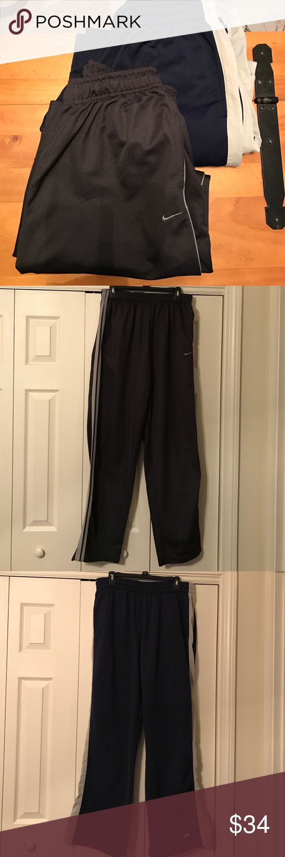 Nike Men's blue/gray athletic pant bundle Nike Men's athletic pant bundle includes: 1 dark gray with light gray stripe and 1 navy blue with gray stripe. Both are XXL and have zipper on bottom of each leg. Both have some slight pilling but otherwise in great condition. Nike Pants Sweatpants & Joggers