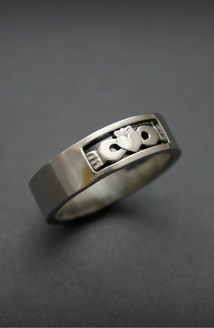 Unique Men's Claddagh Ring  includes the essential symbols of the Irish Claddagh ring designed with a modern contemporary style for the modern wearer. Visit www.claddaghdesign.com to order your bespoke Claddagh ring directly from our Award Winning Silversmith & Irish jewelry designer