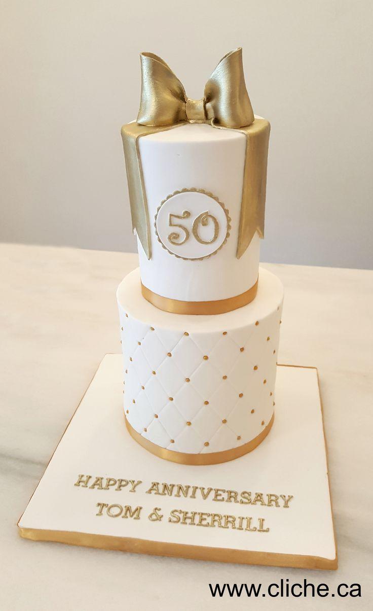 Un beau gâteau doré pour un 50ème anniversaire de mariage!