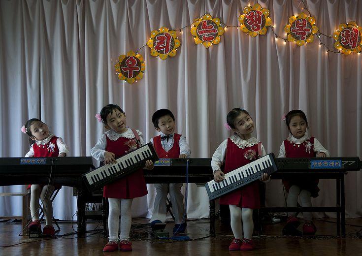 https://flic.kr/p/E89qvi   North Korean children playing music in Kwangbok school, Pyongan Province, Pyongyang, North Korea   © Eric Lafforgue www.ericlafforgue.com