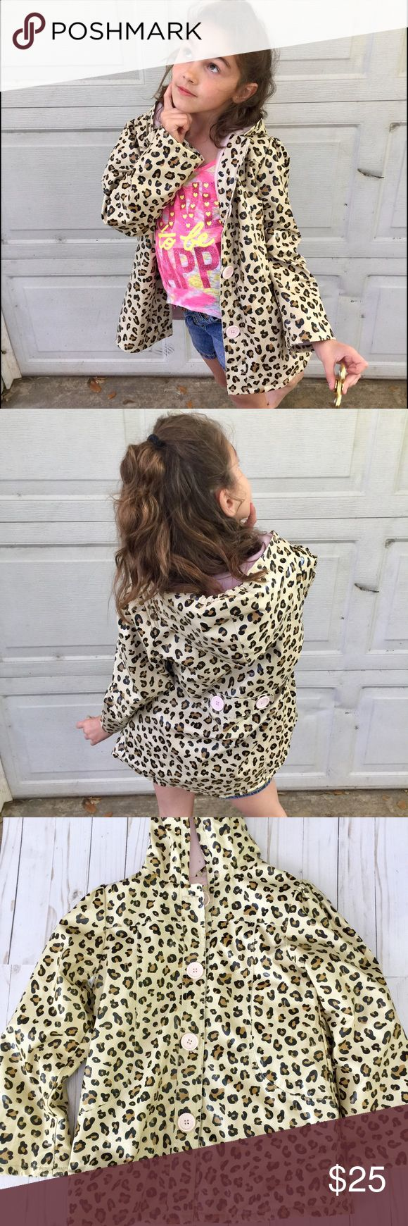 .•Leopard Raincoat• Cute raincoat with big pink buttons. Perfect for those rainy days. Pair with some rain boots to compete this look. Kids Headquarters Jackets & Coats Raincoats