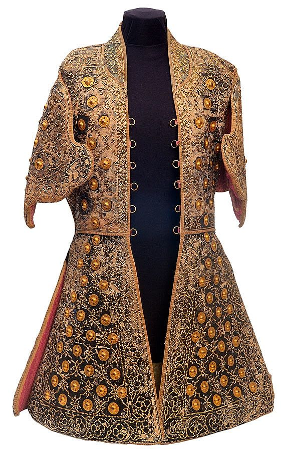 Coat of a Thousand Nails. Rajput chieftain Koer Singh's Indian chilta hazar masha -made of layers of fabric faced with velvet and studded with numerous small brass nails. Stolen from the Indian rebel leader during the uprising of 1857 by Major Vincent Eyre. Currently in the Surrey Infantry Museum, Clandon Park, Guildford England.