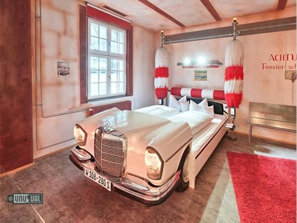 Meilenwerk classic car restoration complex on the old Zeppelin airfield near Böblingen, Germany, the V8 hotel has car themed rooms that allow you to sleep in a Mercedes, Morris Minor, Cadillac or Volkswagen