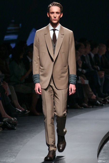 Ermenegildo Zegna. Love the proportions of the jacket, styling with the long sleeved t-shirt peeking out.
