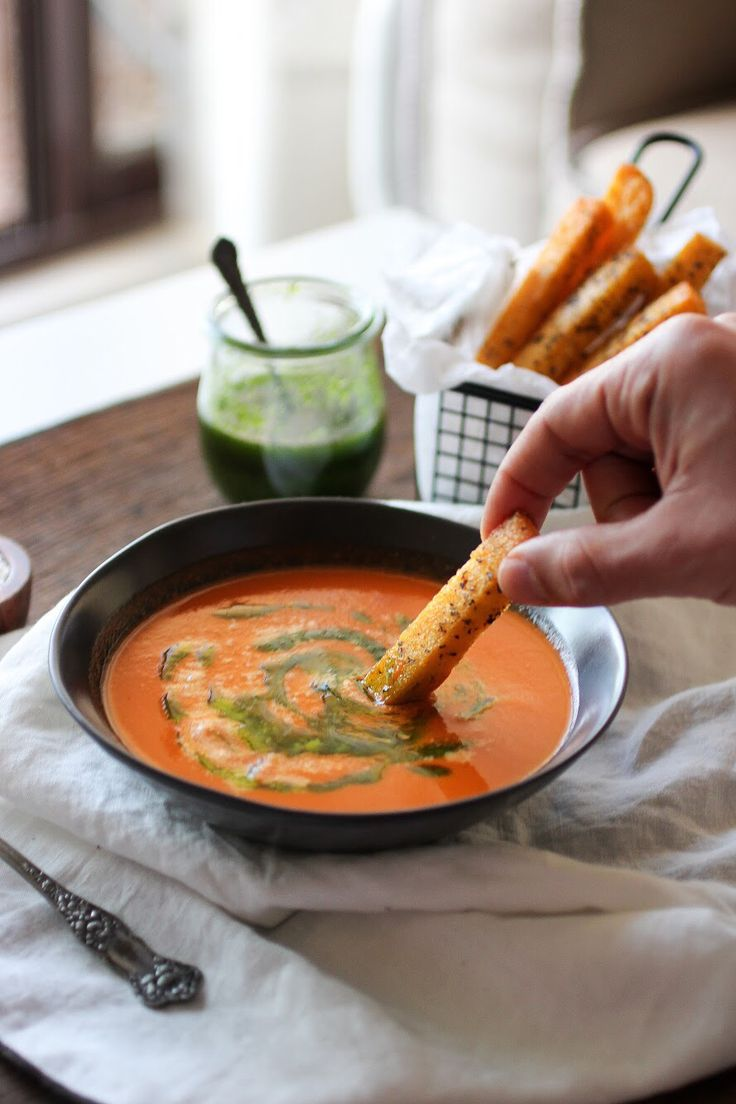"""""""Pizza Soup"""": Roast Tomato soup with Basil oil & baked cheesy Polenta chips."""