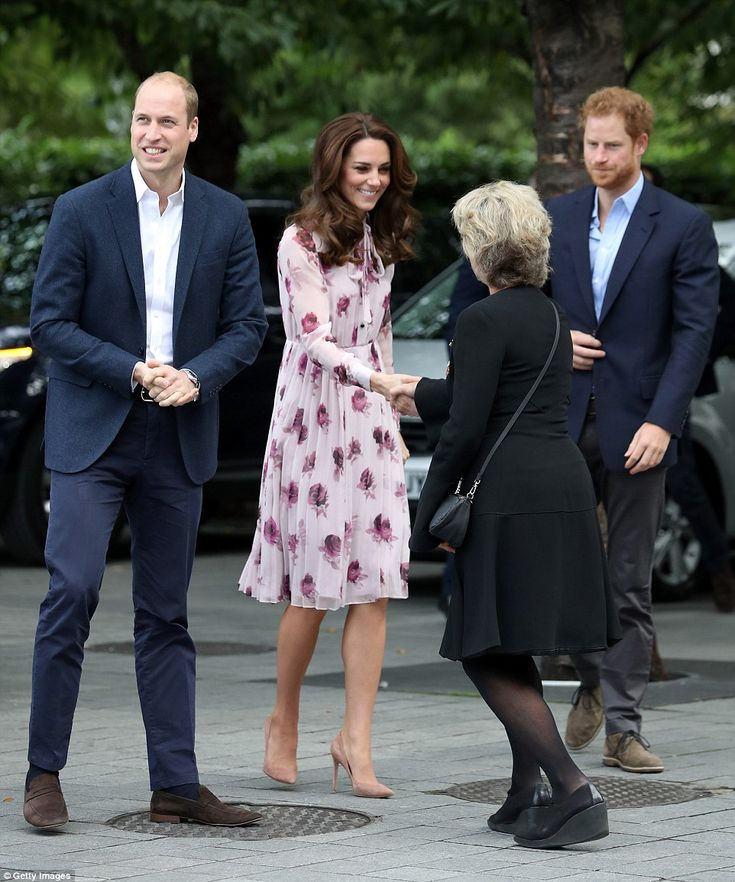 Kate receives a curtsy as she arrives at County Hall for an engagement to mark World Mental Health Day