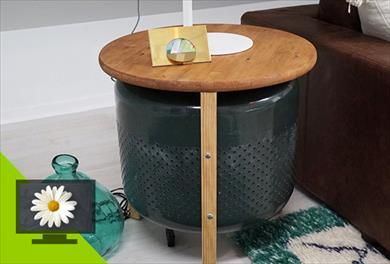 Recycle an old washing machine drum and transform it into an industrial-style table.