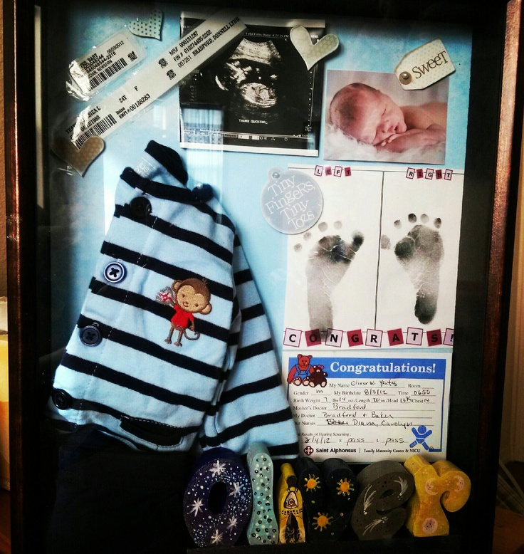 Oliver's Shadow Box: hospital keepsakes, going home outfit, newborn photo & hand painted name plate from his Aunt Kate.