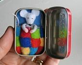 Rabbit garden play set in Altoid tin - with felt rabbit, carrots, basket and snuggle bag. $26.00, via Etsy.