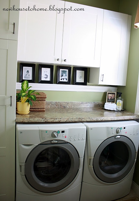Use IKEA Adel cabinets (hardware from Lowe's) above the washer/dryer. (I wonder how well you can reach the stuff in them though)