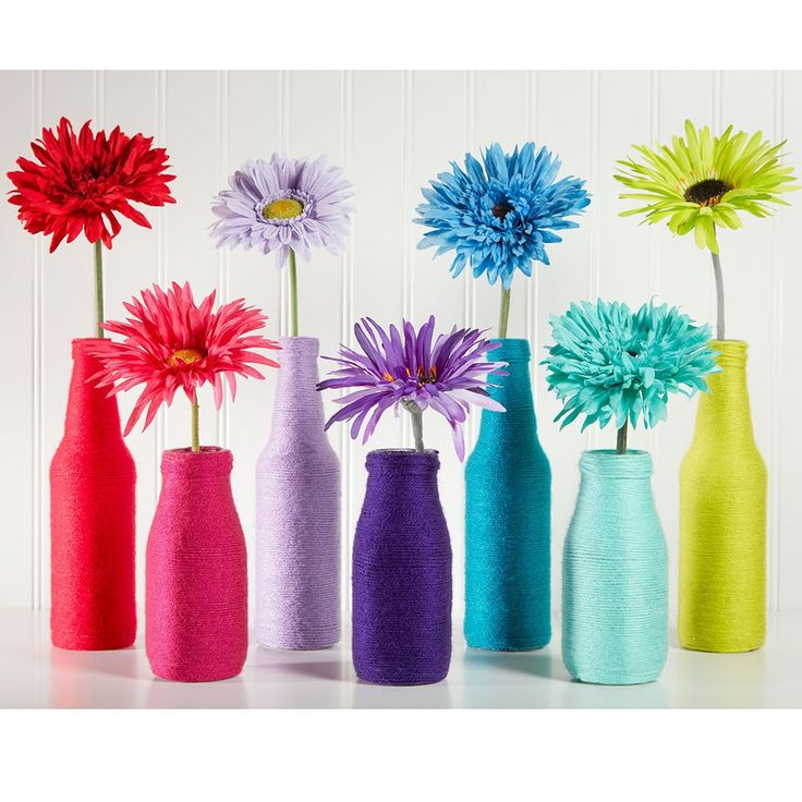 Make these colorful DIY Loops & Threads® Colorwheel™ Rainbow Yarn-Wrapped Bottles