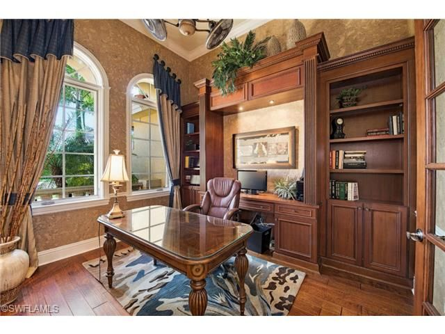 home office study with custom cabinets and colorful rug twin eagles naples florida