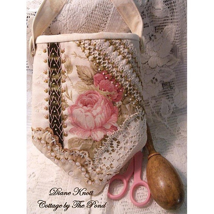 """I ❤ crazy quilting, beading & embroidery . . . Shabby Roses in Bloom Pouch/Wristlet/Purse  6.5"""" by 8.5"""" from top to bottom of point, 14"""" handle- Take your little sewing projects along with you in this sweet little hand sewn pouch. Shabby pink roses are """"framed"""" in the center by vintage tatting on linen, vintage eyelet & lace, as well as a snippet of dark olive green satin ribbon. Creamy pearl seed beads & delicate hand embroidery add to its feminine look. Coffee stained vintage linen on…"""