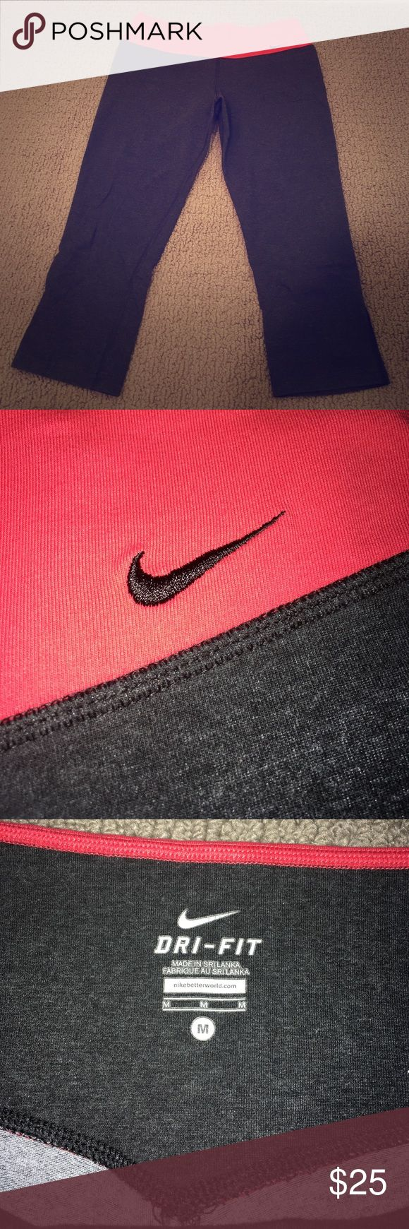 Nike Dri Fit Capris Charcoal grey w/ red waistband Nike running capris. Cottony feel, great for the gym or for lounging! Nike Pants Leggings