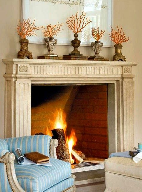 Red Coral on pedestals. Fireplace decor. http://www