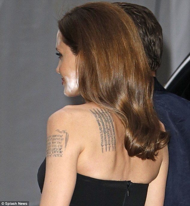 Tatt's not a good look: Angelina is seen from behind, showing off the unfortunate make-up ...