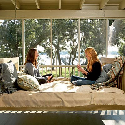 Peaceful Porch    A bed swing piled with blankets and pillows issues an invitation to get comfortable and enjoy the views when there's a chill in the air. Layering fabrics and textures adds warmth that you can both see and feel.
