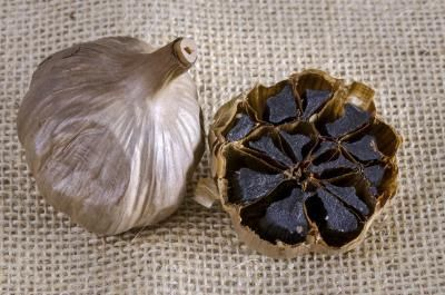 """Though not as well known as its white counterpart, black garlic is enjoying a rise in popularity in gastronomic circles and the alternative medicine field. Introduced to the health and food markets about five years ago by the Koreans, garlic becomes """"black garlic"""" through a monthlong process of fermentation under strictly controlled heat..."""