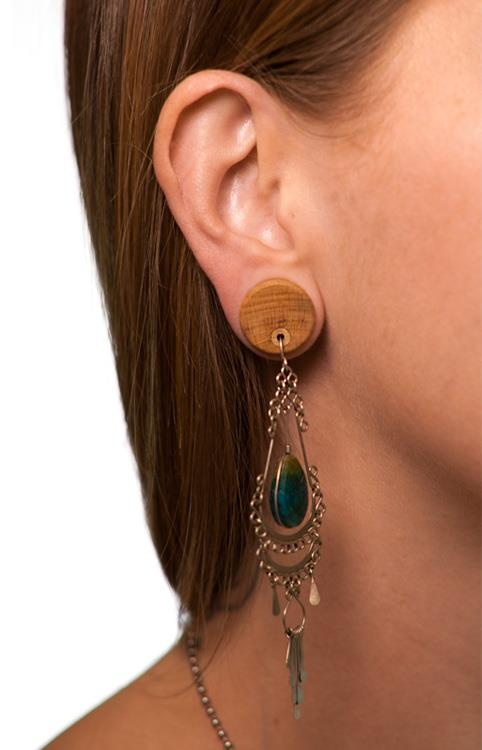 """Omerica """"Earring Plugs: All those cute dangle earrings you left behind when you stretched are wearable again! A tiny tree rubber inlay serves as the mechanism holding earrings securely in place within the plugs."""""""