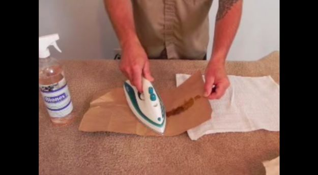Use paper and an iron to remove melted wax (like crayons) from your upholstery.