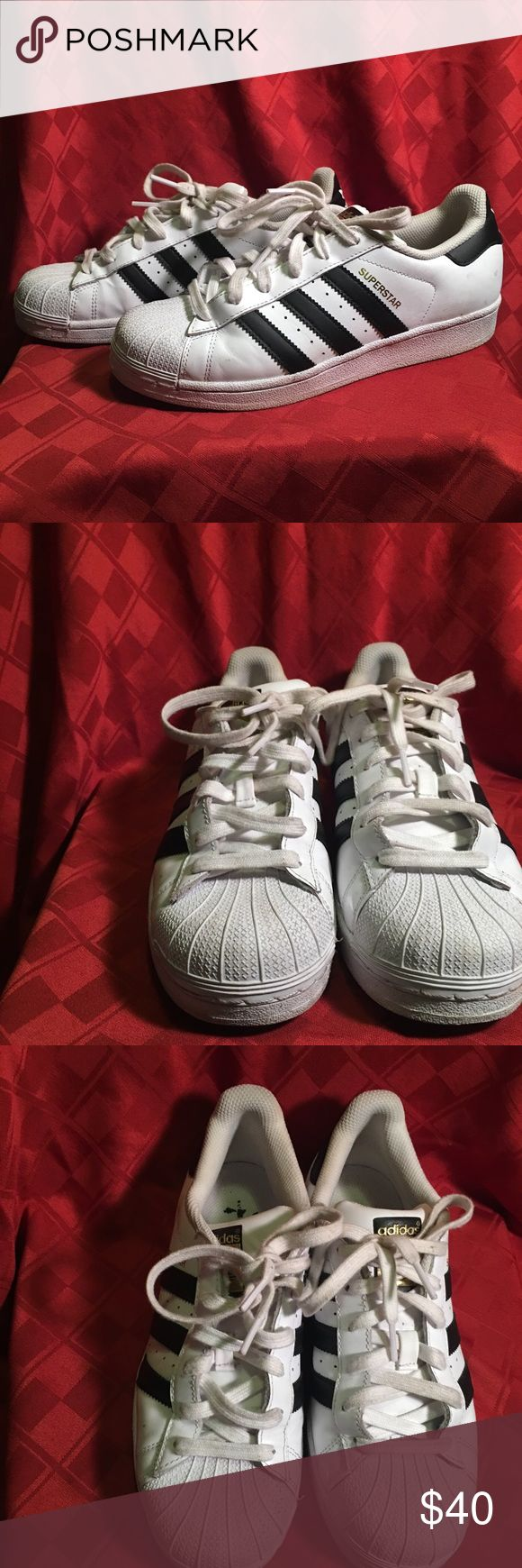 Adidas Superstars These superstars are in pretty good condition and don't have any scuffs or marks. The shoe laces can easily be cleaned and they would look brand new. They are kid shoes and are 6 1/2 but fit like an 8 in women shoes adidas Shoes Athletic Shoes