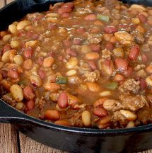 Calico beans recipe with lima beans, kidney beans and pork and beans mixed with ground beef, bacon, and ketchup barbecue flavor sauce. Calic beans for the crockpot or slow cooker, delicious for side dish or picnic cookout.