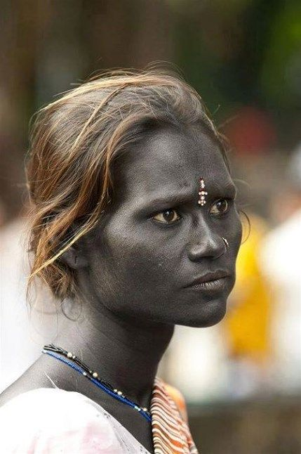 """Like Krishna, this woman is blue black — the blackest blue. Her name is Kushite and she's an Indian Beggar in Mumbai, South India. She is subject to extensive prejudice cause of her dark blue skin! She is Dravidian — The ancient """"blue race"""" of India and it still exists in the bloodlines up to today."""