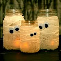 "Halloween Lights - Mason jars, Candles or LED lights, linen wrap and googly eyes fixed with adhesive spray and hot glue gun. Great idea for themed lighting - not gory or too over-the-top! Could make ones with eyelashes next to ones with bow ties as ""bride and groom mummies""."