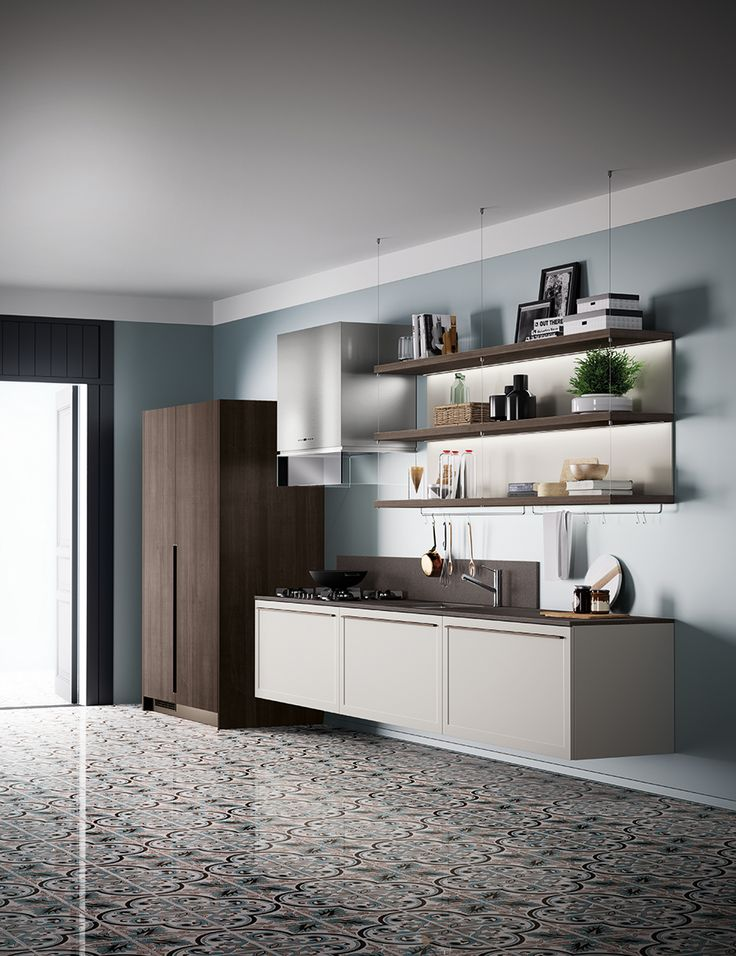 Functionality and light weight for the wall-mounted base units with Light Grey matt lacquered frame door, which make the kitchen even more dynamic. Also, the roomy Saxony Walnut larder unit matches the composition to create an attractive textured effect. The matching handles are a novelty introduced with this model, and they are available in Prestige White, Steel, Bronze and Black.