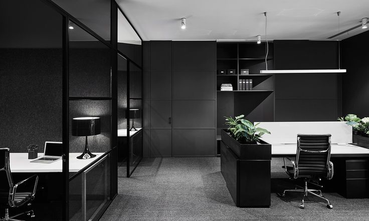 Plus Architecture have created a sleek, monochromatic workspace that reflects Lechte Corporation's needs and aligns with their client's corporate image.