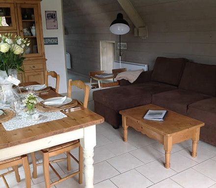 Renovated in 2009, our self-catering apartment, Le Fenil,   meaning hay loft, has two bedrooms, both ensuite, a large living area and a deck with great views over the lush Norman countryside.  This apartment is perfect for groups of four.