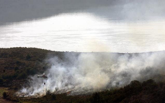 Helicopters dump water on a wildfire near Jordanelle Reservoir on Aug. 19, 2012. (Kim Raff   The Salt Lake Tribune)