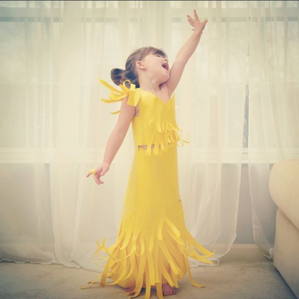 This four year old redefines the whole idea of imaginative dress up with her homemade paper dresses.