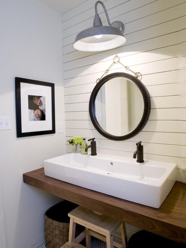 This modern farmhouse bath features a trough sink with double faucets.