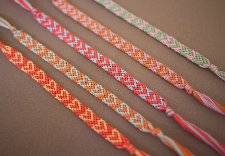This is a fun and very cute tutorial on how to make friendship bracelets with a heart pattern! Glad I saw these too late for this year... very tempting to try!